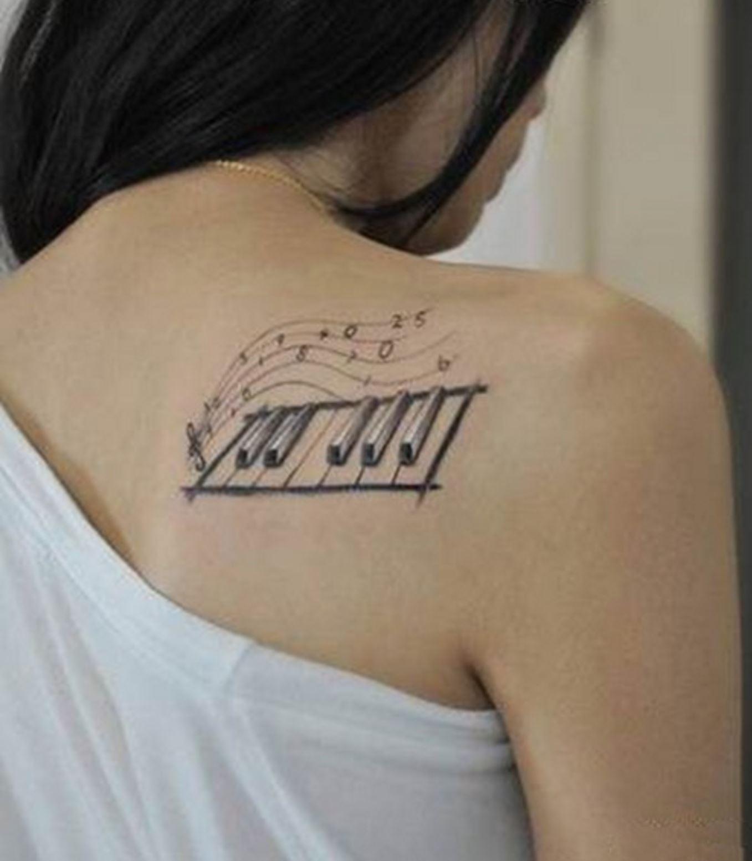 Hình xăm nốt nhạc đẹp ở lưng dành cho nữ
